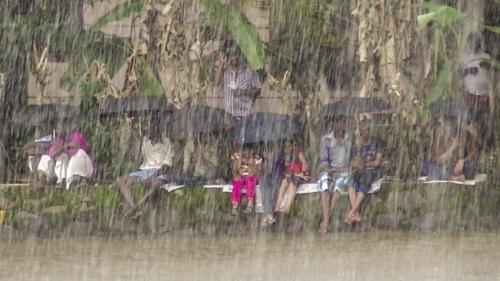 12 points-SPECTATORS SOAKED IN RAIN-Arulramalingam